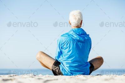 Man training on beach outside