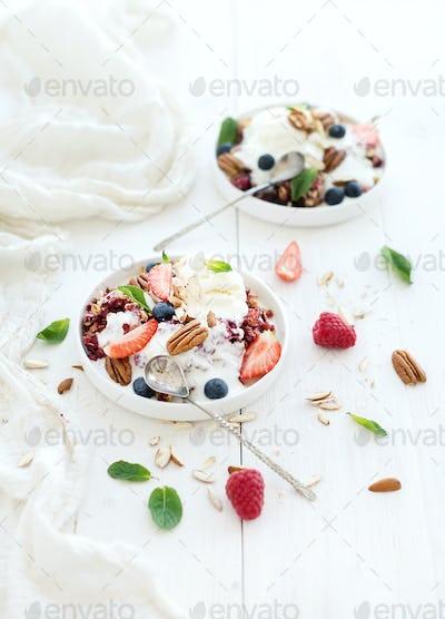 Healthy breakfast. Berry crumble with fresh blueberries, raspberries, strawberries, almond, walnuts