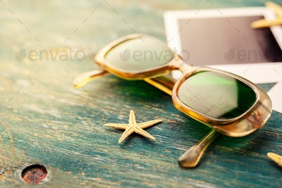 Vintage sunglasses on a wooden table