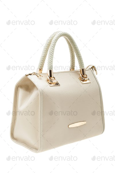 Creme womens bag isolated on white background.