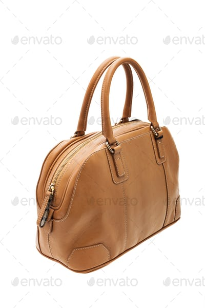 Brown womens bag isolated on white background.