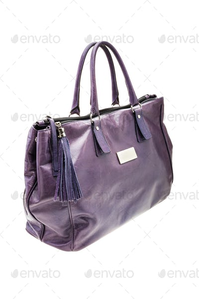 Violet womens bag isolated on white background.