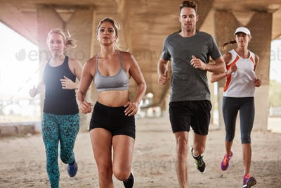 Healthy young people running together