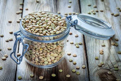 glass jar with organic green lentils