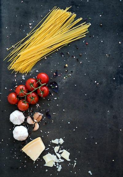 Food frame. Pasta ingredients. Cherry-tomatoes, spaghetti pasta