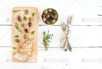 Mediterranean olives with herbs and ciabatta slices