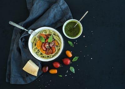 Pasta spaghetti with pesto sauce, basil, slow-roasted cherry-tomatoes