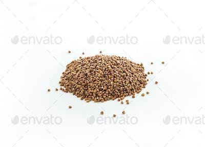 Brown buckwheat groats on white background