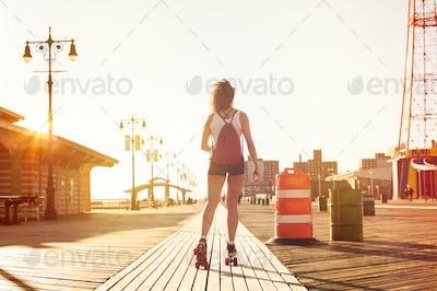 Woman skating on road