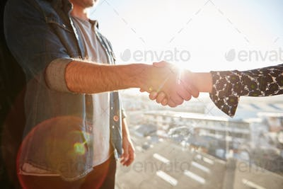 Shaking hands with lens flare