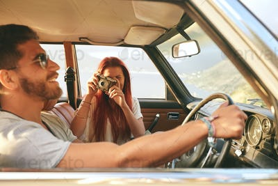 Young couple enjoying on a road trip
