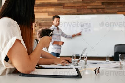 Young woman at presentation in boardroom