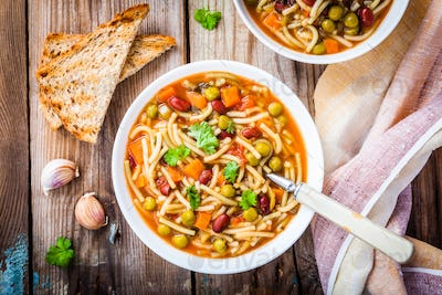 Minestrone soup with whole grain toasts