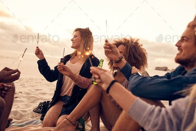 Group of friends celebrating new year's day at the beach