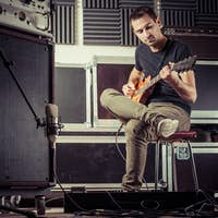 Man recording guitar tracks in a studio