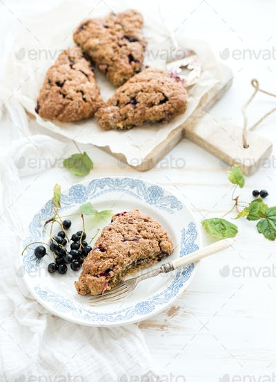 Black-currant scone bisquits with fresh garden berries, top view.