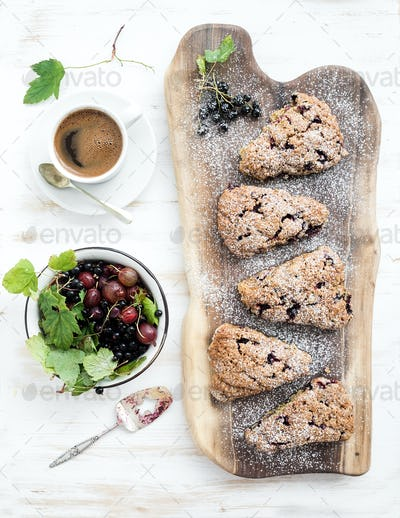 Fresh black-currant scones with coffee and bowl of berries
