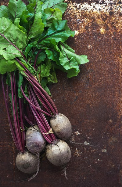 Bunch of fresh garden beetroot over grunge rusty metal backdrop, top view