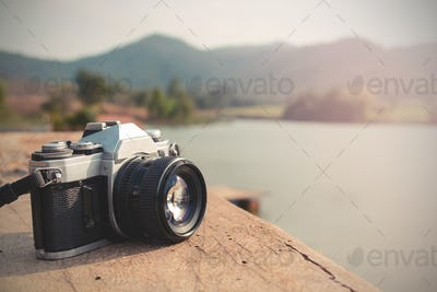 Vintage camera with view of lake and mountain
