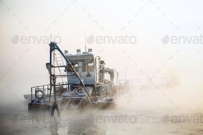 dredge boat in the fog