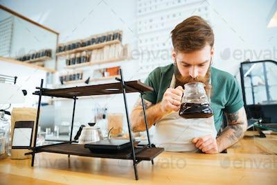 Barista smelling coffee