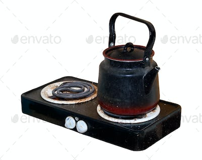 Dirty old electric stove with a kettle