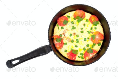 Omelet pan with tomatoes