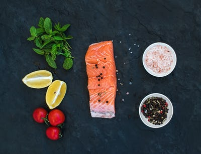 Ingredients. Raw salmon filet, lemon, cherry tomatoes, fresh mint and spices