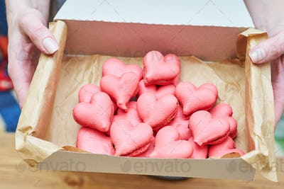 The box of heart-shaped macarons