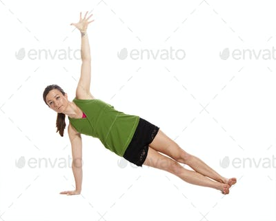 woman doing yoga, plank position