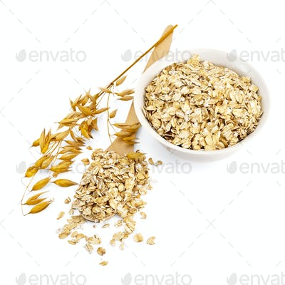 Rolled oats in a bowl and spoon