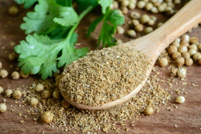 Coriander powder, Aromatic ingredients on rustic wooden table
