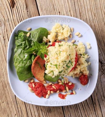 Couscous stuffed tomato