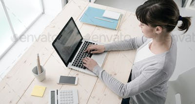 Businesswoman working with a laptop