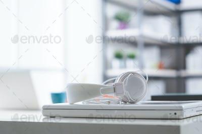 White laptop and headphones