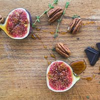 Half fig with chocolate pieces and honey