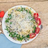Fresh Italian pasta with mushrooms and cream sauce