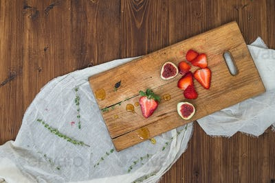 Strawberry and figs on a wooden board