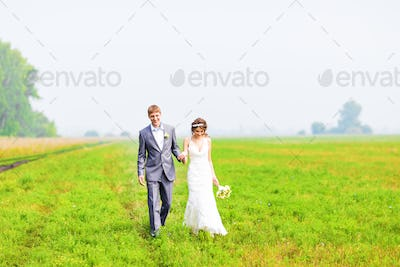 A young couple in love bride and groom, wedding day in summer