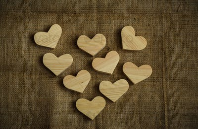Wooden hearts on sackcloth background