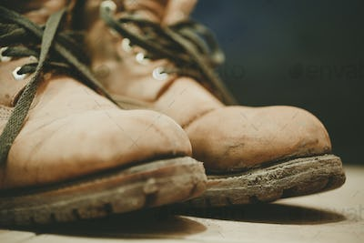 Old and Dirty boots in mud