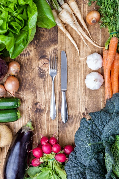 Fresh organic bio vegetables on wooden background