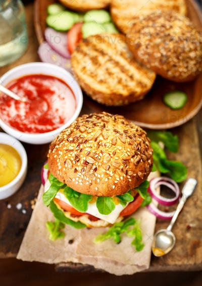Delicious hamburger in rustic setting.