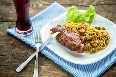 Tasty dishes from turkey meat with rice and salad leaves and a g