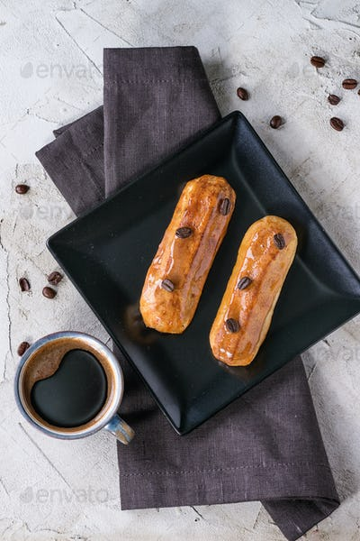 Coffe eclair with cup of coffee