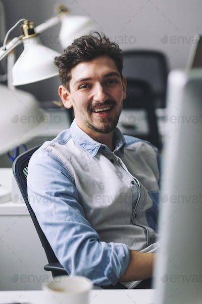 Handsome businessman working in office