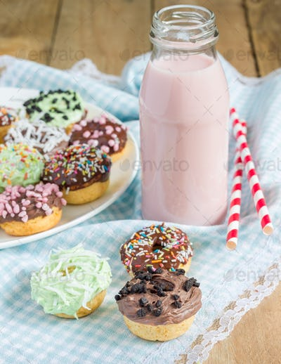 Fresh baked homemade mini donuts with strawberry milk drink