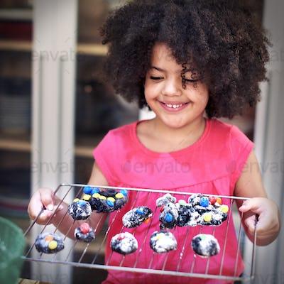 Little Girl Baking Homemade Cookie Hobby Concept