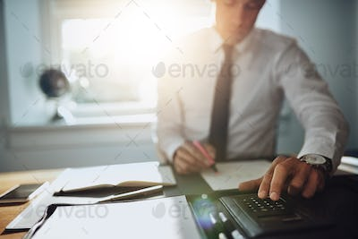 Business man working on documents, close up