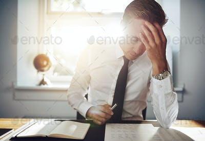 Business man working concentrated on documents